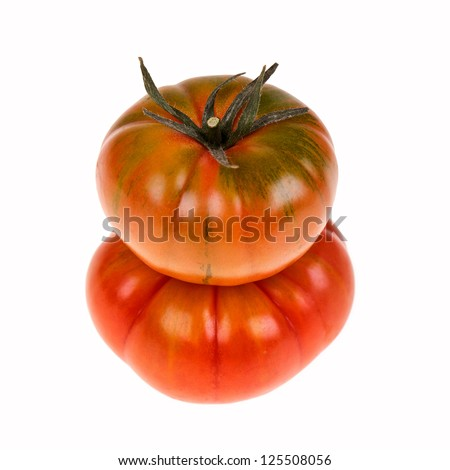 Two heirloom Marmande tomatoes in a stack and isolated on white. Marmande are a continental ribbed variety of beefsteak tomato. - stock photo