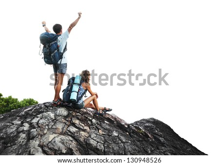 Two hikers with backpacks on top of a mountain isolated on a white background - stock photo