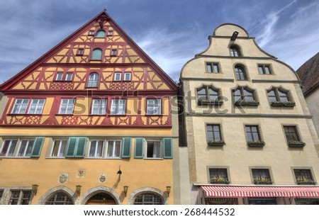 Two historical German houses in Rothenburg ob der Tauber, Germany - stock photo