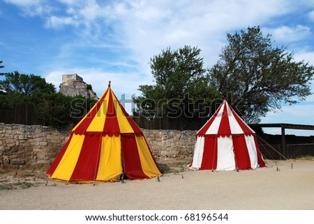 two historical medieval camp tent red, white and yellow - stock photo