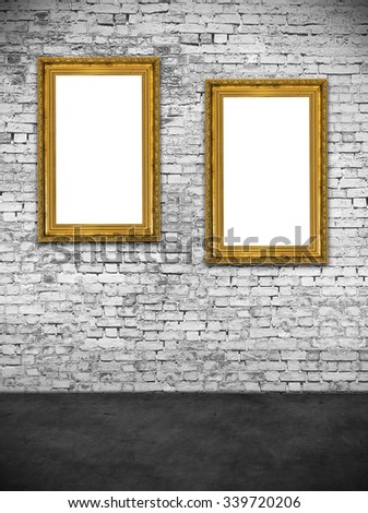 Two hollow frames on white brick wall - stock photo