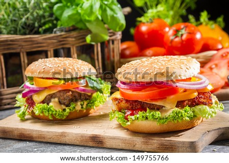 Two homemade hamburgers with fresh vegetables - stock photo