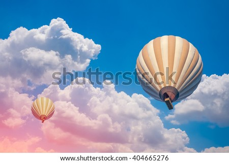 two hot air balloon with cloudy blue sky background - stock photo
