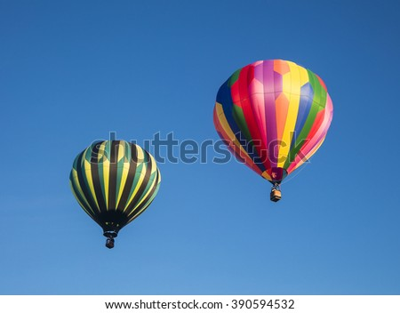 Two hot air balloons against the sky after launch - stock photo