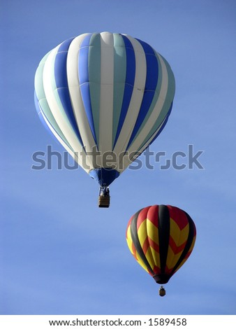 Two hot air balloons flying together