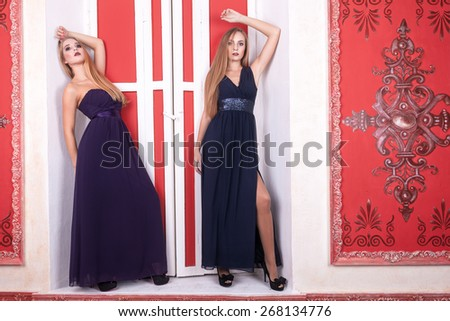 Two hot girl in vintage interior and dresess. Sensuality. Retro style and vintage interior - stock photo