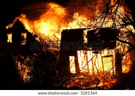 Two house burning down in the middle of the night - stock photo