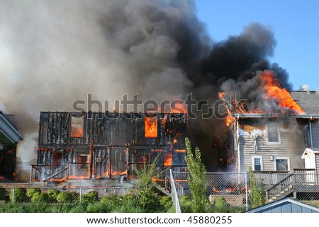 Two houses on fire. - stock photo