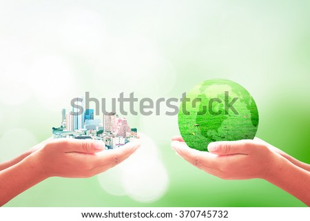 Two human hand hold big city and earth grass. Ecological City World Environment Day Sustainable Development Go Green Eco Friendly Hope Ecofriendly Trust New Life Marketing business CSR Love concept. - stock photo