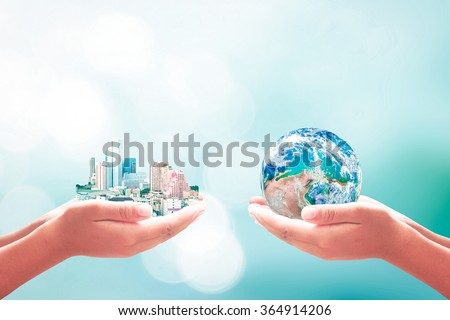 Two human hand hold big city & blue planet. Quality Finance Learning CSR Team Bokeh Trust ROI Water Sea Hope Plan Unity Idea Charity Nature Ecology Global. Elements of this image furnished by NASA. - stock photo