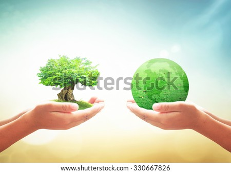 Two human hands holding big plant and the earth of grass over blurred beautiful nature background. Ecology, Environment, Save Trees, Go Green, Eco Friendly, Ecofriendly, Environmentally, Trust concept - stock photo