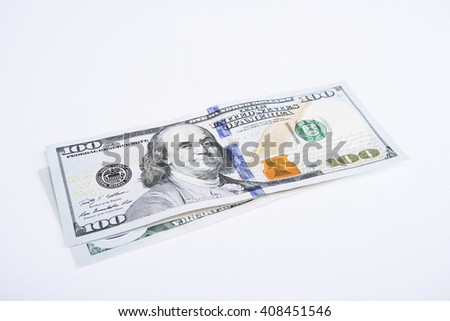 Two hundred dollar banknotes on white surface - stock photo
