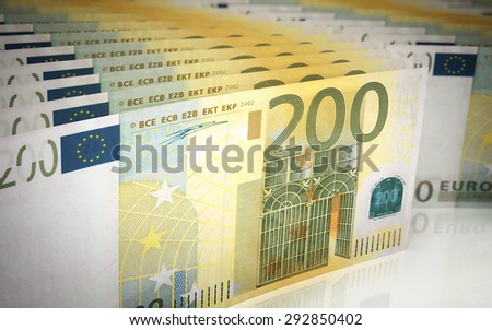 Two hundred euro banknotes stacks (depth of field) - stock photo