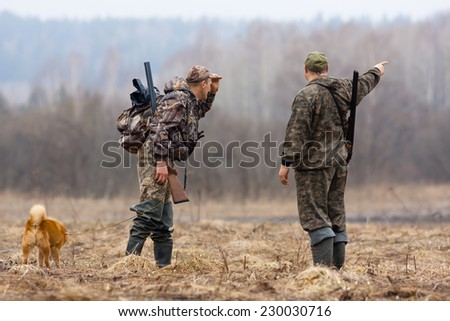 two hunters - stock photo