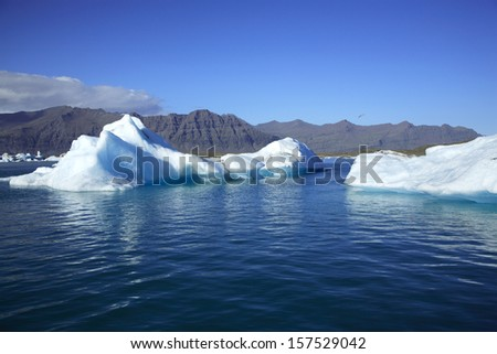 Two icebergs on Jokulsarlon lagoon Iceland - stock photo