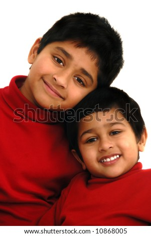 Two indian brothers smiling very happily - stock photo