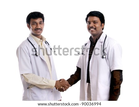Two Indian young doctors posing to the camera. - stock photo