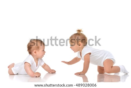 Two Infant child baby girl toddler crawling happy each other straight isolated on a white background