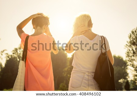 Two injuries friends after an argument - caucasian people  - stock photo