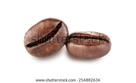 two isolated coffee beans - stock photo