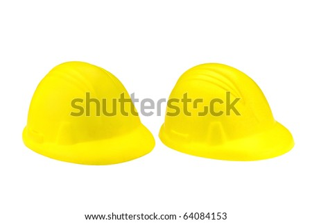 two isolated hard hats