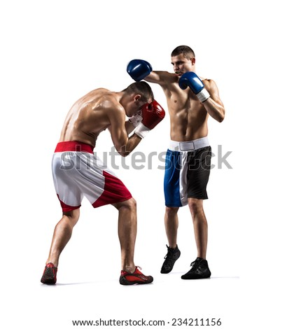 Two isolated professionl boxers are fighting on the white background - stock photo