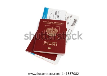 Two isolated Russian passports with boarding passes with clipping path - stock photo