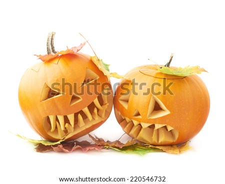 Two Jack-o'-lanterns orange pumpkin heads placed one next to another, both covered with colorful maple leaves, composition isolated over the white background