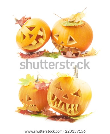 Two Jack-o'-lanterns orange pumpkin heads placed one next to another, both covered with colorful maple leaves, composition isolated over the white background, set of two foreshortenings - stock photo