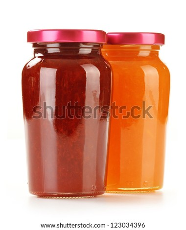 Two jars of fruity jams isolated on white background. Preserved fruits - stock photo