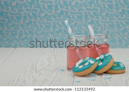 Two jars of pink iced tea and cookies - stock photo