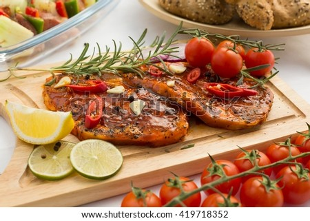 Two juicy chops of fresh pork prepared for barbecue - stock photo