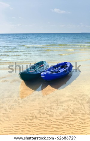 Two kayaks on a tropical beach in Thailand - stock photo