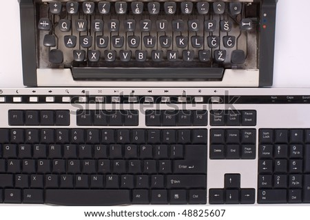 Two keyboards, of old typewriter and computer - stock photo
