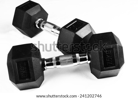 Two 7.5kg dumb-bells black with chrome handles on white background - stock photo