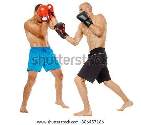 Two kickbox fighters sparring, full length isolated on white background - stock photo