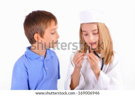 Two kids a boy and girl dressed playing doctor. Isolated on white background. - stock photo