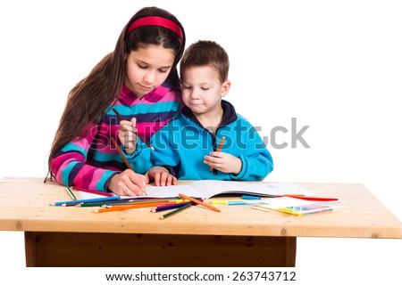 two kids drawing together in notebook, isolated on white - stock photo