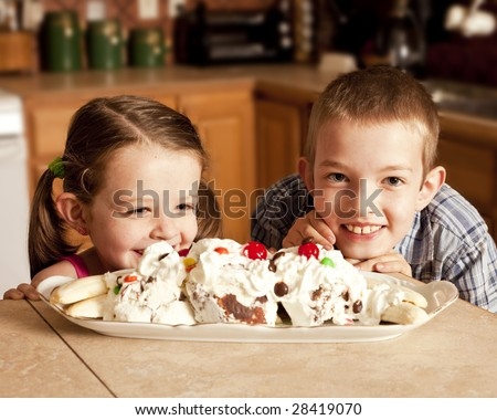 two kids eagerly waiting to eat ice cream - stock photo