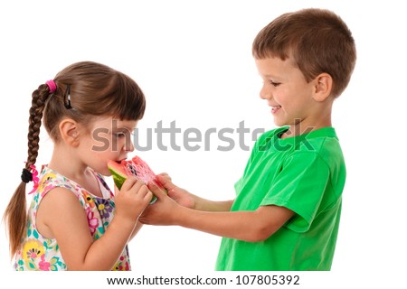 Two kids eating a watermelon, isolated on white - stock photo