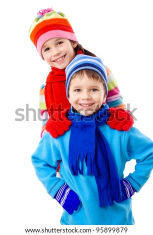 Two kids in winter clothes standing together, isolated on white - stock photo