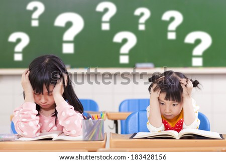 two kids is full of questions in class - stock photo