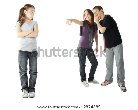 Two kids making fun of a young girl - stock photo