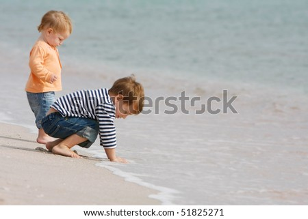 two kids on beach - stock photo