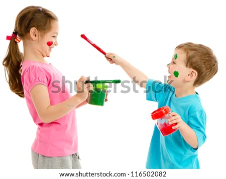 Two kids painting each others faces and having fun. Isolated on white