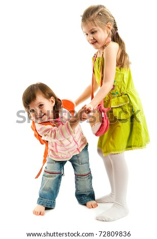 Two kids playing and dancing over a white background