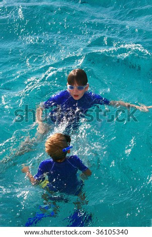 two kids playing in blue water