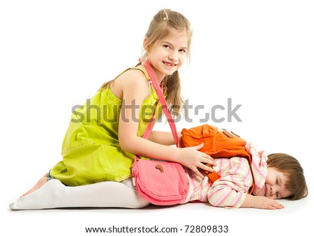 Two kids playing on the floor over a white background - stock photo