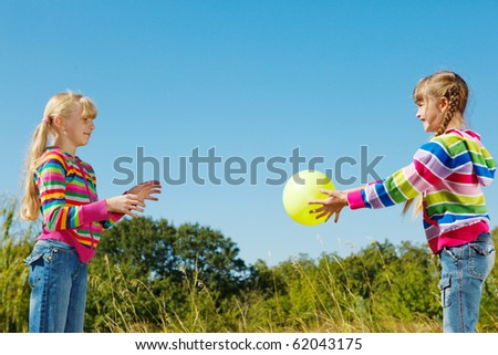 Two kids playing the ball - stock photo