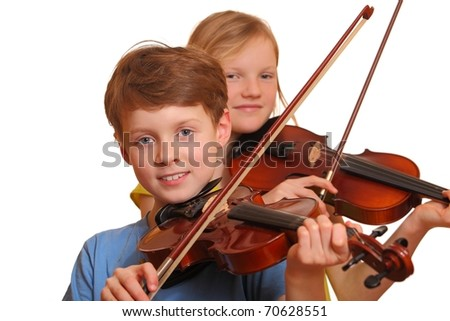 Two kids playing violin isolated on white background - stock photo